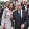 Photo -   French Socialist Party candidate for the presidential election Francois Hollande walks with his companion Valerie Trierweiler, in Tulle, southwestern France, Saturday, May 5, 2012. The second round of the French presidential elections will take place on May 6, 2012. (AP Photo/Bob Edme)