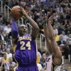 Los Angeles Lakers guard Kobe Bryant (24) goes to the basket as Utah Jazz point guard Alec Burks (10) defends during the second quarter of an NBA basketball game Wednesday, Nov. 7, 2012, in Salt Lake City. (AP Photo/Rick Bowmer)