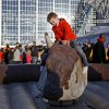 Jude Dodson, 6, of Tulsa rides a mechanical bull before the AT&T Cotton Bowl Classic college football game between the Oklahoma State University Cowboys (OSU) and the University of Missouri Tigers at AT&T Stadium in Arlington, Texas, Friday, Jan. 3, 2014. Photo by Bryan Terry, The Oklahoman