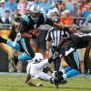 Carolina Panthers\' Cam Newton (1) is upended by a Denver Broncos player during the first half of an NFL football game in Charlotte, N.C., Sunday, Nov. 11, 2012. (AP Photo/Bob Leverone)