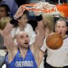 Photo - Orlando Magic forward Marcin Gortat (13) dunks against the Los Angeles Lakers during the first half of Game 1 of the NBA basketball finals   Thursday, June 4, 2009, in Los Angeles.  (AP Photo/Jae C. Hong)  ORG XMIT: LAS206