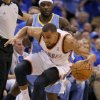 Oklahoma City\'s Thabo Sefolosha (2) grabs a loose ball from Denver\'s Ty Lawson (3) during the first round NBA playoff game between the Oklahoma City Thunder and the Denver Nuggets on Sunday, April 17, 2011, in Oklahoma City, Okla. Photo by Chris Landsberger, The Oklahoman