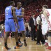 Oklahoma City Thunder\'s Kendrick Perkins (5) and Serge Ibaka, center, exchange words with Houston Rockets\' Omer Asik (3) in the first quarter of Game 6 in a first-round NBA basketball playoff series Friday, May 3, 2013, in Houston. (AP Photo/Pat Sullivan)
