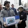 Sean Lennon and Yoko Ono help deliver boxes of comments to the New York State Department of Environmental Conservation on its proposed natural gas drilling regulations on Friday, Jan. 11, 2013, in Albany, N.Y. Environmental, health and community groups opposed to shale gas drilling and hydraulic fracturing, or