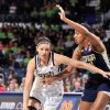 Notre Dame forward Natalie Achonwa, left, drives the lane as Georgia Tech center Shayla Bivins defends the first half of an NCAA college basketball game, Monday, Feb. 17, 2014, in South Bend, Ind. (AP Photo/Joe Raymond)