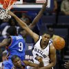 Memphis Grizzlies forward Rudy Gay (22) gets the ball knocked away by Oklahoma City Thunder\'s Kevin Durant (35) and Serge Ibaka (9), of the Republic of Congo, during the first half of a preseason NBA basketball game Wednesday, Oct. 7, 2009, in Memphis, Tenn. (AP Photo/Lance Murphey) ORG XMIT: TNLM104