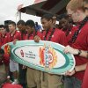 Photo - The OU men's basketball team accepts a surfboard during fan fest before the college football game between the University of Oklahoma Sooners (OU) and Florida State University Seminoles (FSU) at the Gaylord Family-Oklahoma Memorial Stadium on Saturday, Sept. 11 2010, in Norman, Okla.   Photo by Steve Sisney, The Oklahoman