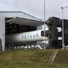 In this Tuesday, Oct. 2, 2012 photo made available by NASA, the SpaceX Falcon 9 rocket with the Dragon capsule attached begins a rollout demonstration test in Cape Canaveral, Fla. On Sunday night, Oct. 7, 2012, the private space company will attempt to launch another capsule full of food, clothes and science experiments for the astronauts at the space station. The company hopes to repeat the success of its test flight in May 2012. (AP Photo/NASA, Jim Grossmann)