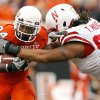 OSU\'s Kendall Hunter gets past Nebraska\'s Terrence Moore during the college football game between the Oklahoma State Cowboys (OSU) and the Nebraska Huskers (NU) at Boone Pickens Stadium in Stillwater, Okla., Saturday, Oct. 23, 2010. Photo by Sarah Phipps, The Oklahoman