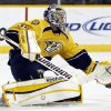 Photo - Nashville Predators goalie Pekka Rinne, of Finland, blocks a shot against the Los Angeles Kings in the first period of an NHL hockey game, Thursday, Feb. 7, 2013, in Nashville, Tenn. (AP Photo/Mark Humphrey)