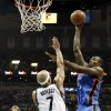 Oklahoma City\'s Serge Ibaka (9) shoots against Memphis\' Jerryd Bayless (7) as Mike Conley (11) looks on during Game 3 in the second round of the NBA basketball playoffs between the Oklahoma City Thunder and Memphis Grizzles at the FedExForum in Memphis, Tenn., Saturday, May 11, 2013. Photo by Nate Billings, The Oklahoman