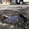A pothole at the intersection of NW 45 and Walker in Crown Heights addition, Tuesday, Feb. 15, 2011. Photo by Jim Beckel, The Oklahoman ORG XMIT: KOD