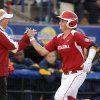 Oklahoma\'s Georgia Casey slaps hands with coach Patty Gsso after she hit a home run against California in the sixth inning of their Women\'s College World Series game at ASA Hall of Fame Stadium in Oklahoma City, Friday, June 1, 2012. Photo by Bryan Terry, The Oklahoman