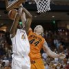 Texas\' Prince Ibeh, left, is blocked by Oklahoma State defender Philip Jurick, right, as he tries to score during the first half of an NCAA college basketball game, Saturday, Feb. 9, 2013, in Austin, Texas. (AP Photo/Eric Gay) ORG XMIT: TXEG103