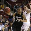 Colorado\'s Chucky Jeffery (23) drives past Stanford\'s Sara James in the first half of an NCAA college basketball game in the Pac-12 Conference tournament Saturday, March 9, 2013, in Seattle. (AP Photo/Elaine Thompson)