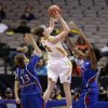Iowa State\' Hallie Christofferson (5) goes up for a score as Kansas\' Monica Engelman (13) and Chelsea Gardner (15) defend in the second half of an NCAA college basketball game in the Big 12 women\'s tournament Saturday, March 9, 2013, in Dallas. Christofferson had 23-opints in the 77-62 win over Kansas. (AP Photo/Tony Gutierrez)