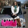 Photo -   Part-time Lyft driver Brittany Cameron sits on the hood of her own vehicle, which she uses to give rides, and which is adorned with Lyft's trademark pink mustache, in downtown Denver. AP Photo  <strong>Brennan Linsley -  AP </strong>