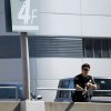 Police stand guard outside Los Angeles International Airport on Friday, Nov. 1, 2013. A gunman armed with a semi-automatic rifle opened fire at the airport on Friday, killing a Transportation Security Administration employee and wounding two other people. Flights were disrupted nationwide. (AP Photo/Ringo H.W. Chiu)