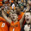 Oklahoma State\'s Cezar Guerrero (1) celebrates with Jean-Paul Olukemi (0) and Markel Brown (22) after winning an NCAA college basketball game between the Oklahoma State University Cowboys (OSU) and the University of Texas-San Antonio Roadrunners at Gallagher-Iba Arena in Stillwater, Okla., Wednesday, Nov. 16, 2011. Photo by Bryan Terry, The Oklahoman