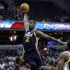 Utah Jazz\'s Marvin Williams (2) is fouled by Washington Wizards\' Trevor Booker, left, during the first half of an NBA basketball game, Saturday, Nov. 17, 2012, in Washington. (AP Photo/Nick Wass)