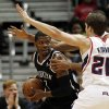 Brooklyn Nets shooting guard Joe Johnson (7) is covered by Atlanta Hawks\' Al Horford (obscured) and Kyle Korver (26) in the first half of an NBA basketball game on Wednesday, Jan. 16, 2013, in Atlanta. (AP Photo/John Bazemore)
