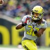 Photo - Oregon's Ayele Forde catches a pass during their spring NCAA college football game on Saturday, May 3, 2014, at Autzen Stadium in Eugene, Ore. (AP Photo/The Oregonian, Thomas Boyd)  MAGS OUT; TV OUT; LOCAL TV OUT; LOCAL INTERNET OUT; THE MERCURY OUT; WILLAMETTE WEEK OUT; PAMPLIN MEDIA GROUP OUT