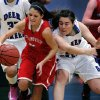 Collinsville\'s Shelbie Kirby (left) tries to keep the ball away from the defense of Deer Creek\'s Raven Crisp (32), during their first round 5A girls playoff matchup, in Catoosa, on Thursday, March 7, 2013. CORY YOUNG/Tulsa World