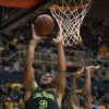 Photo - Baylor's Rico Gathers, left, lays in a basket as West Virginia's Brandon Watkins defends during the first half of an NCAA college basketball game Saturday, Feb. 22, 2014, in Morgantown, W.Va. (AP Photo/Andrew Ferguson)