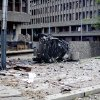 The wreckage of a car lies outside government buildings in the centre of Oslo, Friday July 22, 2011, following an explosion that tore open several buildings including the prime minister\'s office, shattering wiondows and covering the street with documents.(AP Photo/Fartein Rudjord) NORWAY OUT: ORG XMIT: LON851