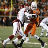 Oklahoma State\'s Damian Davis is hit by Brian Jackson of Oklahoma during the first half of the college football game between the University of Oklahoma Sooners (OU) and Oklahoma State University Cowboys (OSU) at Boone Pickens Stadium on Saturday, Nov. 29, 2008, in Stillwater, Okla. STAFF PHOTO BY NATE BILLINGS