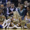 Oklahoma City Thunder\'s Kevin Durant (35) falls into the Golden State Warrior girls during the second half of an NBA basketball game against the Golden State Warriors Wednesday, Jan. 23, 2013, in Oakland, Calif. (AP Photo/Ben Margot) ORG XMIT: OAS107