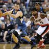 Photo - Minnesota Timberwolves' JJ Barea (11) runs against Portland Trail Blazers' Mo Williams (25) during the first half of an NBA basketball game in Portland, Ore., Sunday Feb. 23, 2014. (AP Photo/Greg Wahl-Stephens)