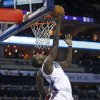 Charlotte Bobcats\' Michael Kidd-Gilchrist, front, shoots over Washington Wizards\' Emeka Okafor, back, during the first half of an NBA basketball game in Charlotte, N.C., Tuesday, Nov. 13, 2012. (AP Photo/Chuck Burton)