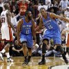 The Thunder\'s James Harden (13) is congratulated by teammate Kevin Durant (35) after Harden scored against the Miami Heat in the fourth quarter of Wednesday\'s game. AP photo