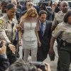 Actress Lindsay Lohan is escorted by Los Angeles County sheriffs as she arrives for her trial with her attorney Mark Heller, on Monday, March 18, 2013. Lohan is charged with three misdemeanor counts stemming from a crash on Pacific Coast Highway. She is charged with willfully resisting, obstructing or delaying an officer, providing false information to an officer and reckless driving. She is also accused of violating her probation in a misdemeanor jewelry theft case. (AP Photo/Damian Dovarganes)