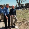 President Bill Clinton walks with Governor Frank Keating down a Del City Street, Angela Drive. Behind are Cathy Keating and James Lee Witt, FEMA director.