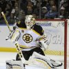 Photo - Boston Bruins goaltender Chad Johnson makes a blocker save during the first period of an NHL hockey game against the Buffalo Sabres in Buffalo, N.Y., Wednesday, Oct. 23, 2013. (AP Photo/Gary Wiepert)