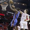 Oklahoma City\'s Kevin Durant (35) shoots as Houston\'s Omer Asik (3) defends during Game 6 in the first round of the NBA playoffs between the Oklahoma City Thunder and the Houston Rockets at the Toyota Center in Houston, Texas, Friday, May 3, 2013. Photo by Bryan Terry, The Oklahoman