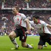 Photo - Liverpool's Steven Gerrard, centre, celebrates with teammate Luis Suarez after scoring against Manchester United during their English Premier League soccer match at Old Trafford Stadium, Manchester, England, Sunday March 16, 2014. (AP Photo/Jon Super)