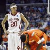 Oklahoma\'s Austin Johnson (20) stands over Syracuse\'s Jonny Flynn (10) during the second half of the NCAA Men\'s Basketball Regional at the FedEx Forum on Friday, March 27, 2009, in Memphis, Tenn. PHOTO BY CHRIS LANDSBERGER, THE OKLAHOMAN