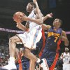 Oklahoma City's Kevin Durant, left, drives past Golden State's Kelenna Azubuike on Monday at the Ford Center. Azubuike played high school ball at Tulsa's Victory Christian. By Nate Billings, the Oklahoman