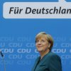 German Chancellor and chairwoman of the German Christian Democratic party, CDU, Angela Merkel, smiles as she arrives for a news conference after a party\'s board meeting in Berlin, Monday, Sept. 23, 2013. German Chancellor Angela Merkel may have won an impressive third general election but she faces a delicate and lengthy task in forming a new government as party leaders met Monday to map out their next steps. Merkel\'s Union bloc achieved its best result in 23 years Sunday to put her on course for a third term, winning 41.5 percent of the vote and finishing only five seats short of an absolute majority in the lower house. However, Merkel\'s pro-business coalition partner since 2009 crashed out of Parliament. Words read: For Germany. (AP Photo/Matthias Schrader)