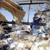 Thor Clemens cleans up tornado damage at his home, Thursday, Feb. 12, 2009, in Lone Grove, Okla. PHOTO BY SARAH PHIPPS, THE OKLAHOMAN