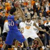 Oklahoma State \'s Michael Cobbins (20) defends on Kansas\' Kevin Young (40) during the college basketball game between the Oklahoma State University Cowboys (OSU) and the University of Kanas Jayhawks (KU) at Gallagher-Iba Arena on Wednesday, Feb. 20, 2013, in Stillwater, Okla. Photo by Chris Landsberger, The Oklahoman