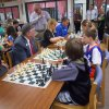 Photo -  Members of the Rotary Club of Edmond, a supporter of Ida Freeman Elementary, take chess lessons and compete with the nationally ranked school team that will compete in the national competition Saturday. PHOTO PROVIDED      -