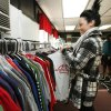 Student Hannah Scott hangs up clothing donations at Westmoore High School in Moore, OK, Tuesday, Nov. 22, 2011. Westmoore High School is being creative in giving back with a program for giving clothes to students who can\'t afford them. By Paul Hellstern, The Oklahoman