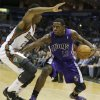 Sacramento Kings\' Tyreke Evans (13) drives against Milwaukee Bucks\' Doron Lamb, left, during the first half of an NBA basketball game on Wednesday, Dec. 12, 2012, in Milwaukee. (AP Photo/Jeffrey Phelps)