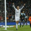 Photo - Real Madrid's Cristiano Ronaldo from Portugal, centre, celebrates his goal during a Spanish La Liga soccer match between Real Madrid and Celta Vigo at the Santiago Bernabeu stadium in Madrid, Spain, Monday, Jan. 6, 2014. (AP Photo/Andres Kudacki)