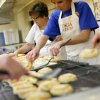 Karaleen Jordan (left) and Amy Foster set out apricot kolaches to cool at Oklahoma Czech Hall in Yukon, Oklahoma on Tuesday, July 12, 2011. Volunteers will prepare more than 2,000 kolaches for the Czech Festival on Oct. 1 in Yukon. Photo by John Clanton, The Oklahoman