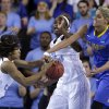 North Carolina guard Danielle Butts, left, and center Waltiea Rolle try to rebound a ball against Delaware guard/forward Elena Delle Donne during the second half of a second-round game in the women\'s NCAA college basketball tournament in Newark, Del., Tuesday, March 26, 2013. Delaware won 78-69. (AP Photo/Patrick Semansky)